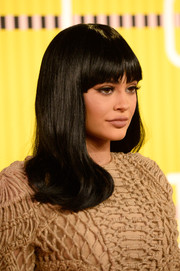 Kylie Jenner hit the MTV VMAs wearing her hair with wavy ends and rounded bangs.