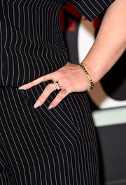 Kelly Osbourne wore assorted rose gold rings and bangles from Anne Sisteron to the VMAs.