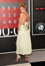 Bella Thorne paired her alluring dress with silver evening sandals by Stuart Weitzman.
