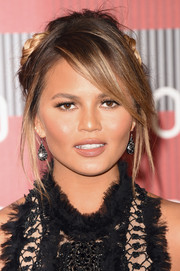 Chrissy Teigen worked an edgy vibe with this messy braided updo at the MTV VMAs.