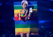 Miley Cyrus looked characteristically bizarre in a rainbow board dress by Agatha Ruiz de la Prada at the 2015 MTV VMAs.