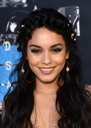 Vanessa Hudgens complemented her boho hairstyle with a pair of large hoop earrings by Jacquie Aiche when she attended the MTV VMAs.