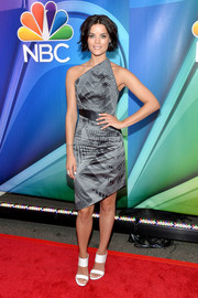 Jaimie Alexander completed her red carpet look with a pair of white broad-strap sandals.