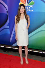 Miranda Cosgrove looked sleek and sophisticated in a white tux-style dress during the NBC Upfront Presentation.