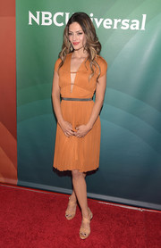 Sandra Vergara looked ravishing at the NBCUniversal Summer Press Day in an ochre cocktail dress with a strappy, deep-V neckline.