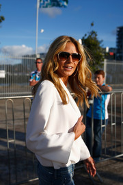Heidi Klum kept the rays out with a pair of designer shield sunglasses while attending the NRL season launch.