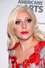Lady Gaga made her eyes pop with bright orange shadow and black liner.