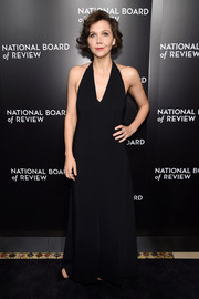 Maggie Gyllenhaal went for a minimalist-chic look in a black halter gown by The Row during the National Board of Review Gala.