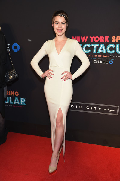 Sami Gayle looked very mature and sophisticated at the New York Spring Spectacular in a long-sleeve ivory evening dress with a thigh-high slit.