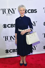 Helen Mirren donned a simple yet classy navy dress, styled with a white belt, for the Tony Award nominees meet-and-greet event.