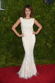 Jennifer Grey looked ageless in a white lace and feather mermaid gown by Zac Posen at the Tony Awards.