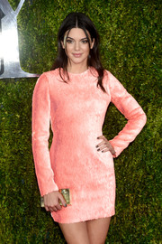 Kendall Jenner made an appearance at the Tony Awards sporting this gold box clutch and pink mini dress combo.