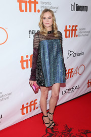Diane Kruger was all aglitter at the TIFF premiere of 'Disorder' in a beaded sheer-panel shift dress by Prada.