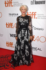 Helen Mirren looked as classy as ever in a black-and-white rose-print gown by Dolce & Gabbana at the TIFF premiere of 'Eye in the Sky.'