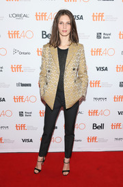 Marine Vacth attended the 'Families' photocall at TIFF wearing a gold jacquard jacket and black cigarette pants.