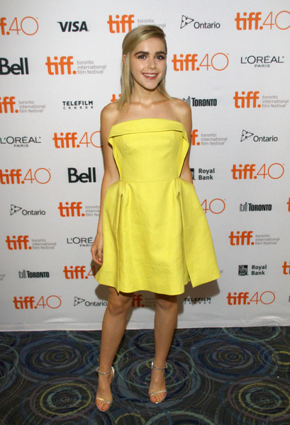 Silver ankle-strap sandals polished off Kiernan Shipka's playfully chic outfit.