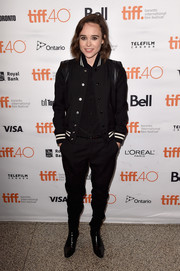 Elliot Page was sporty-edgy in a Saint Laurent varsity jacket and tapered slacks during the TIFF premiere of 'Into the Forest.'