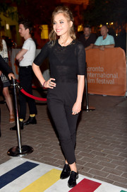 Imogen Poots completed her attire with a pair of black patent oxfords.