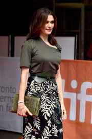 Rachel Weisz attended the TIFF premiere of 'The Lobster' carrying an olive-green snakeskin clutch.