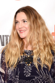Drew Barrymore worked a hippie vibe with her voluminous center-parted waves at the TIFF premiere of 'Miss You Already.'