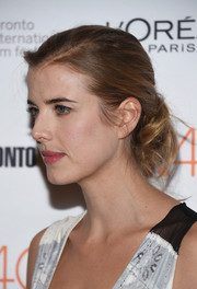 Agyness Deyn opted for a simple, loose chignon when she attended the 'Sunset Song' photocall at TIFF.