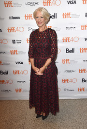 Helen Mirren kept it classy in an embroidered burgundy gown by Dolce & Gabbana during the TIFF premiere of 'Trumbo.'