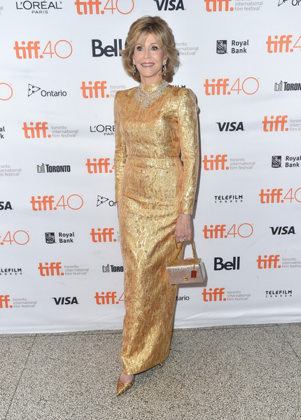 Jane Fonda kept the shimmer coming with a gold YSL purse.