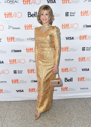 Jane Fonda went for high shine in a long-sleeve gold evening dress by Yves Saint Laurent Couture during the TIFF premiere of 'Youth.'