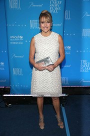 Katie Couric styled her dress with silver Jimmy Choo Lance sandals.