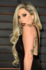Lady Gaga went full-on glam with these flowing blonde curls at the Vanity Fair Oscar party.