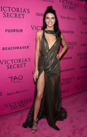 Kendall Jenner flaunted major leg and cleavage in a shiny moss-green cutout gown by Versace at the Victoria's Secret fashion show after-party.