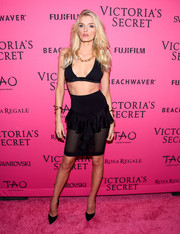 Lily Donaldson put her cleavage and toned abs on show in a black bra top while walking the Victoria's Secret pink carpet.