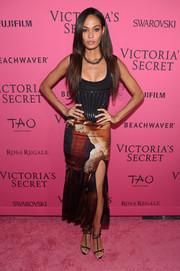 Joan Smalls highlighted her slim frame in a low-cut black corset top by Givenchy at the Victoria's Secret fashion show after-party.