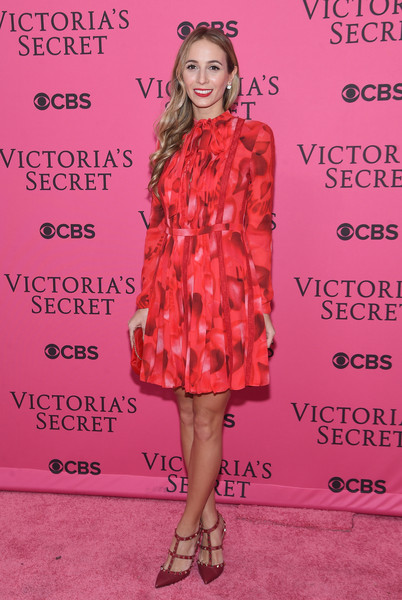 Harley Viera-Newton kept it conservative in a long-sleeve red print dress at the Victoria's Secret fashion show.
