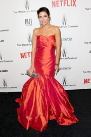 Liz Fraley was a head turner in an iridescent orange mermaid gown at the Weinstein Company and Netflix Golden Globes party.