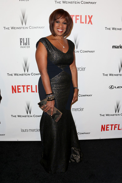 Gayle King attended the Weinstein Company and Netflix Golden Globes party wearing a dark brocade evening dress.