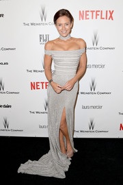 Nicky Whelan was modern and sexy in a tight-fitting gray off-the-shoulder gown by J'Aton Couture at the Weinstein Company and Netflix Golden Globes party.