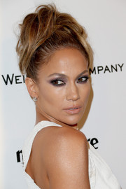 Jennifer Lopez brushed her hair up into a punky 'do for the Weinstein Company and Netflix Golden Globes party.