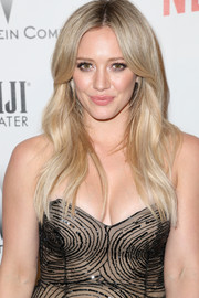 Hilary Duff attended the Weinstein Company and Netflix Golden Globes party wearing her hair with a center part and just a hint of wave.