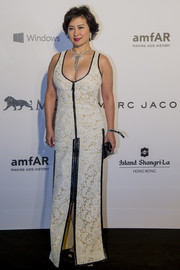 Pansy Ho chose a low-cut white lace gown with black leather trim for her amfAR Hong Kong Gala look.