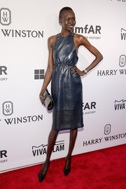 Alek Wek made an appearance at the amfAR Inspiration Gala rocking a sleeveless blue leather dress.