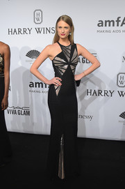 Julie Henderson showed off her slender physique at the amfAR New York Gala in an asymmetrical black Herve Leger by Max Azria bandage dress with a geometric-sequined bodice.