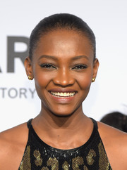 Oluchi Orlandi slicked her hair back into a classic Croydon facelift for the amfAR New York Gala.