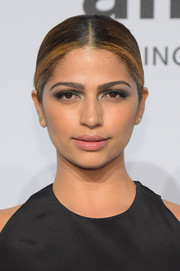 Camila Alves styled her tresses into a simple center-parted ponytail for the amfAR New York Gala.
