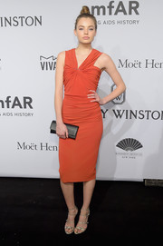 Kristine Froseth donned a ruched red cocktail dress by Lanvin for the amfAR New York Gala.