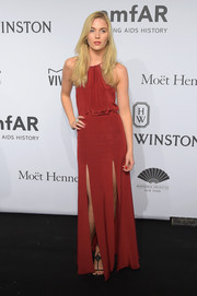 Ammalie Overbeck looked sassy at the amfAR New York Gala in a red halter gown with double slits.