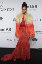 Grace Mahary took the boho-glam route in a red Sophie Theallet floral gown when she attended the amfAR New York Gala.