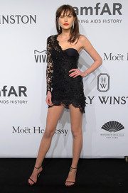 Catherine McNeil vamped it up in a tiny black one-shoulder dress during the amfAR New York Gala.
