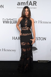 Julia Restoin-Roitfeld looked super slim and sultry at the amfAR New York Gala in a black Philipp Plein gown rendered in see-through lace stripes.
