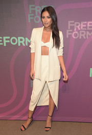 Shay Mitchell made business wear look so alluring with this white high-slit skirt suit by Ganni at the ABC Freeform Upfront.